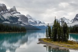 Peaceful staggering view of the green Spirit Island, turquoise Maligne lake and sharp snowy mountains of Jasper National Park, Canada